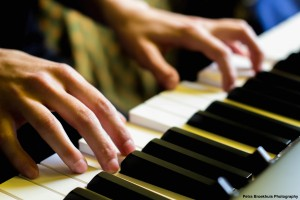 Charlotte Juma Piano Keys Close Up Sign